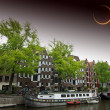 Solar Eclipse over the city Amsterdam. Elements of this image fu — Stock Photo #47033267