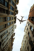 Plane over the city of Brussels tilt - shift  — Stock Photo