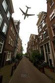 Plane over Amsterdam — 图库照片
