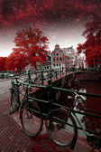 Amsterdam autumn night. Elements of this image furnished by NASA — Stock fotografie