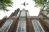 Plane over Amsterdam — Stock Photo