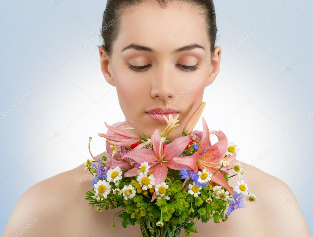 Beautiful girl with wildflowers  Stock Photo #12401643