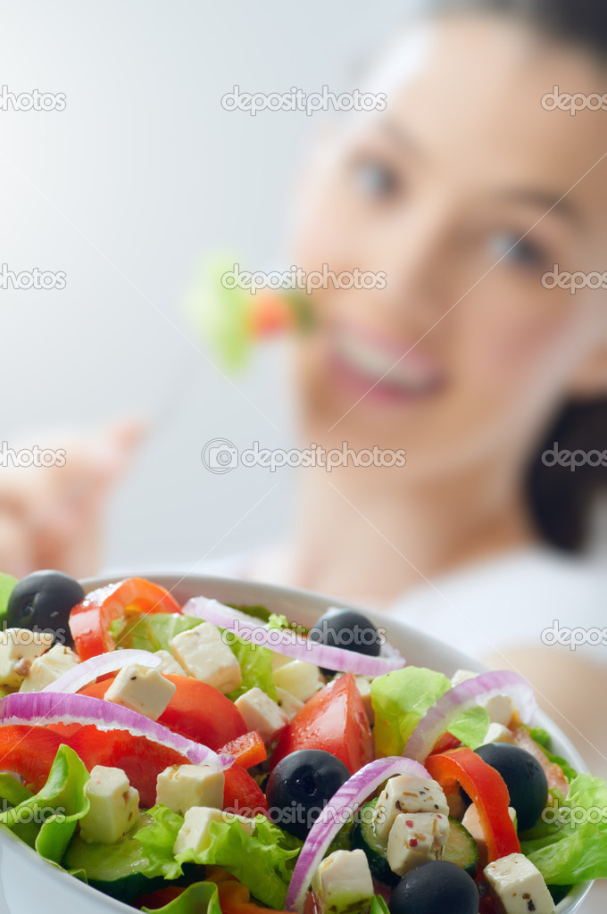 A beautiful girl eating healthy food  Stock Photo #13339976