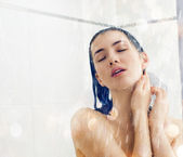 Girl at the shower — Stock Photo