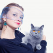 Woman in a veil holding gray British cat — Stock Photo