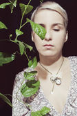 Portrait of a young woman with a passion fruit plant on — Stock Photo