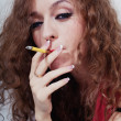 Beautiful young woman with cigarette - Stock Photo