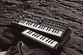 Music synthesizer lying on rocks close up — Stock Photo