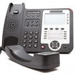 Stock Photo: Black IP phone close up isolated