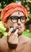 Man smoking pipe in glasses — Stock Photo
