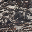Texture rocky shore with sand — Stockfoto