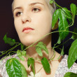 Portrait of a young woman with a passion fruit plant — Stock Photo