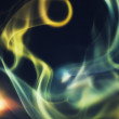 Abstract colorful smoke on a black background — Stockfoto