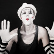 Mime in striped gloves and white hat — Stock Photo