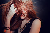 Red-haired young girl with hair fluttering — Stock Photo