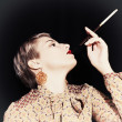 Retro portrait of young woman with cigarette — Stock Photo #44532891
