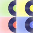 Vinyl records on colored backgrounds — Stock Photo #44935525