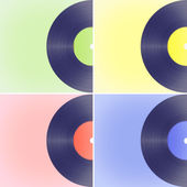 Vinyl records on colored backgrounds — Stock Photo