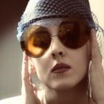 Young woman in a retro sunglasses — Stock Photo #5973385
