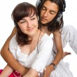 Young couple listens to music in earphones — Stock Photo