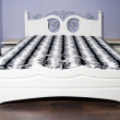 White bed in modernist style — Stock Photo