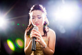 Singing woman of Asia — Stock Photo