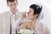 The groom and the bride drink water — Stock Photo