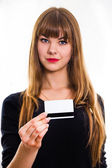 The young girl holds out business card. — Stock Photo