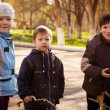 Children in park in autumn — Stock Photo #34922161