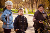 Children in park in the autumn — Stock Photo