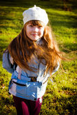 Little girl in park in the autumn — Stock Photo
