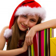 Christmas gifts and small girl Santa — Stock Photo