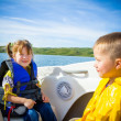 Travel of children on water in the boat — Stock Photo #50003479