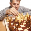 The chess player on a white background — Stock Photo