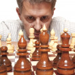 Focused man thinks on game of chess — Stock Photo