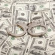 Handcuffs on money background Criminal concepts — Stock Photo