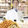 Farmer sells eggs - Stock Photo