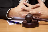 Referee hammer and a man in judicial robes — Stock Photo