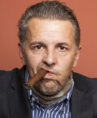 Man wearing suit gangster style smoking cigar — Stock Photo