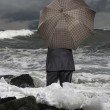 Stock Photo: Economic crisis. Businessmwith umbrella