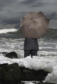 Economic crisis. Businessman with umbrella — Stock Photo