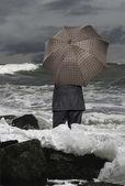Economic crisis. Businessman with umbrella — Stock Photo