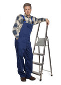 Worker with a stepladder isolated on white — Stock Photo