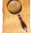Magnifying glass and old paper — Stockfoto