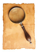 Magnifying glass and old paper — Stock fotografie
