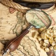 Magnifying glass, map and Gold Nugget — Stock Photo