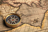 Vintage compass and old map — Stock Photo