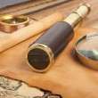Brass telescope on map - Stock Photo