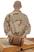 Soldier in courtroom — Stock Photo