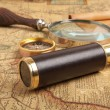 Brass telescope on map — Stock Photo #26029251